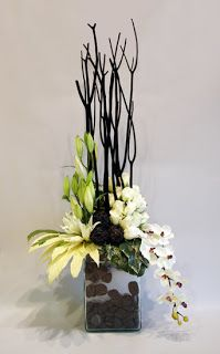 This with red anthurium and red roses on the left, tall red branches, aqua OR white dendrobiums on the right.