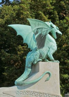 dragon in verdigris in Ljubljana, Slovenia. Small bridge with 4 dragons each corner. DONE! Dragon Statue, Dragon Art, Blue Dragon, Magical Creatures, Fantasy Creatures, Fantasy Dragon, Fantasy Art, Greek Statues, Buddha Statues