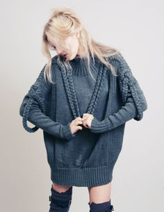 oversized gray cable knit sweater.  Great paired with the skinniest of jeans, or just black opaque tights!