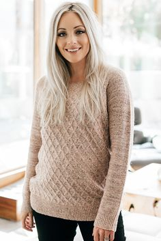 The unique details on this sweater will get you compliments all day long! A gorgeous diamond pattern highlights the heathered blush yarns while the back features a full-length exposed zipper. Wear it