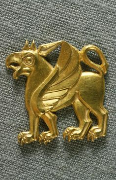 Gold plaque in the form of a winged griffin with a lion's body and the head of a bird of prey. 499-400 BC. Via Noel P