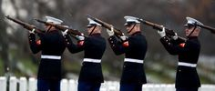The firing squad renders salute  during a full military honors burial for US Marine Staff Sergeant Vincent J. Bell at Arlington National Cemetery, in Arlington, Va., on Dec. 27, 2011. Bell,  was supporting Operation Enduring Freedom at the time of his death in Afghanistan. (JIM WATSON/AFP/Getty Images)