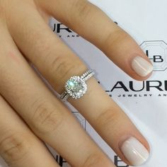 Our RS-83 cathedral #cushionhalo ring with a 1.15 carat center diamond.  This style works really well with a matching band as you can see by the flush fit between the two rings.  Customizable for any size or quality center diamond on www.laurenb.com