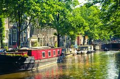 Go on a canal tour - No visit is complete without gliding along the splendid canals of Amsterdam on a boat. The canals were declared a UNESCO monument in 2010 and, during the 17th-century, weren't just a picturesque attraction, they were essential for transportation within the city.