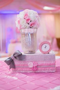 Pretty centerpieces at a ballerina baby shower party! See more party planning ideas at CatchMyParty.com!