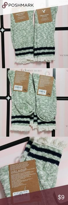 American eagle lace crew socks NWT Two pairs of American Eagle crew socks, both NWT.  The socks are grey with white lace and dark blue stripes. They're a taller, crew sock style. They're not very thick though.  Would be very cute with a dress or leggings and boots!  Retail for both is $18 American Eagle Outfitters Accessories Hosiery & Socks