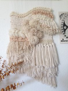 This gorgeous handmade cream, blush, & gold woven wall hanging is the perfect statement piece for any room in the house  It has tons of texture-