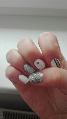 Elegant nails design, white, silver and black.