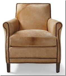 Serena & Lily chair covered in gorgeous cowhide and trimmed in nailhead.
