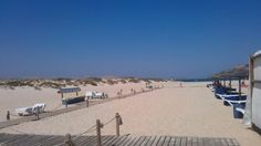 Tavira Island, Algarve. You can only access this beach by boat & it is well worth it. There is a lovely fish restaurant in the middle of the island.