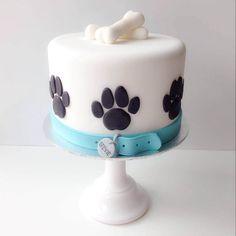 White dog cake with bones and paws. # Dogs cake 12 Cute Dog Cakes and Dog Shaped Birthday Cake Puppy Birthday Cakes, Puppy Birthday Parties, Puppy Party, Fondant Dog, Fondant Cakes, 3d Cakes, Fondant Figures, Paw Print Cakes, Pug Cake