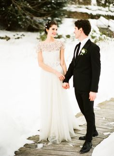 Photography : Lindsay Madden Photography   Wedding Dress : Marchesa From Gabriella Bridal Salon   Grooms Attire : Suitable NYC Read More on SMP: http://www.stylemepretty.com/2015/12/06/snow-filled-winter-wedding-inspiration/