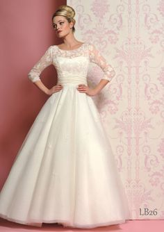 This would be my choice for the wedding I'm not having. lol Love it! Lace 3/4 sleeved ball gown. Lou Lou Bridal.