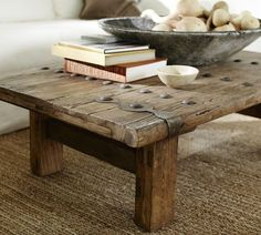 Reclaimed wood coffee table with some hardware on it. old-barn-wood-furniture