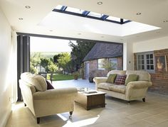 Bespoke orangery includes a five-panel folding door system, and is lit from above by a roof light. Style At Home, Orangerie Extension, Moderne Pools, Roof Lantern, Sky Lantern, Interior And Exterior, Interior Design, Roof Light, House Extensions
