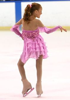 Pretty Skating Dress. Her attudie is so cute!