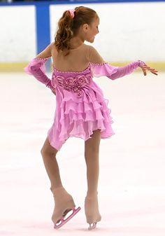 Pretty Skating Dress. Her attudie is so cute!