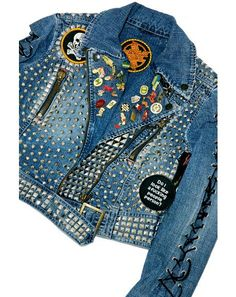 Hazmat Design Vintage Deadstock Black Sabbath Studded Denim Jacket This one of a fukkin' kind vintage denim moto jacket is savagely handmade and features a slim fit, long corset inspired lace-up sleeves and has been beautifully hand embellished with heavy metal studs including a large Black Sabbath patch gracing yer back and perfectly placed patches. Complete with a cropped cut, sik xXxtra rare vintage pins on the collar, dual side pockets and asymmetrical front zipper closure.