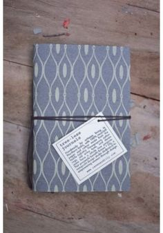 a nice journal made with recycled cotton paper and textiles