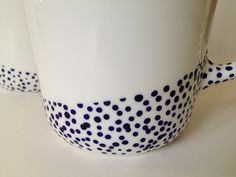 dipped dot mugs tutorial with porcelain paint... could do a whole set of dishes : ) via fabricpaperglue.com