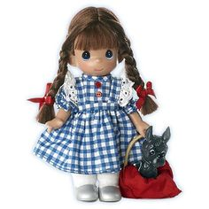 """Home is a place never to be taken for granted. Dressed as the famed Dorothy, this fresh-from-the-farm creation will have you recalling all her wonderful adventures over the rainbow. Petitely-sized, it's easy to collect all her friends as well! Vinyl doll. 7"""" H."""