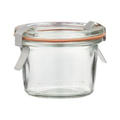 """""""With the rise in home canning and preserving, it's only natural we'd revisit these German classics-keeping it fresh since 1900. Unlike other canning jars, Wecks feature an open tapered shape that's easier to fill and empty, rust-free glass lids no can opener required, and sealing gaskets that are easy to check at a glance. Jars double as fun drinking glasses and stack for convenient storage. -Soda lime glass -Stainless steel clamps, rubber seals -Dishwasher-, microwave- and ..."""