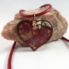 This antique copper heart pendant has been hand painted with acrylic and enamel colours of glittering scarlet, matte red, pink, and silver. It hangs from an red leather cord, and features a delightful copper accent charm. Leather Cord, Red Leather, Copper Accents, Matte Red, Antique Copper, Louis Vuitton Speedy Bag, Cuff Bracelets, Jewelry Making, Hand Painted