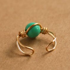 Turquoise Ear Cuff Gold Tone Wire Wrapped Ear Cuff. $5.00, via Etsy.