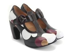 """John once said that perspectives are like really great snacks – you can't have just one. While the suggestion was not groundbreaking, it did end up guiding in the creation of The Views, a family that happily embraces looking different from each angle. Crafted in Portugal from smooth Italian leathers, The Arbus is a thick t-strapped 3.75"""" platform heel with a strong but not singular point of view. Things look different from a distance."""