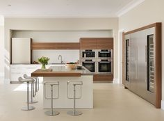 The large bulthaup kitchen in white laminate and wood veneers creates a calm environment to cook and dine. White Laminate, Property Development, Wood Veneer, Kitchen Design, Home Improvement, Dining, Interior Design, Country, Case Study