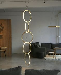 The Circus Pendant by Resident Lighting New Zealand is a series of interconnecting rings to create a vertical light source of 2 to 6 rings. Pendant Lighting, Chandelier, Loft Design, Art Object, Home Interior Design, Ceiling Lights, Ceiling Lamp, Lanterns, Architecture Design