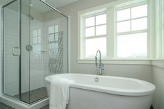 """The floor and shower tile both are American Florim Stratos-Porcelain shown in """"Anthracite"""" -- comes in a variety of sizes. Counter is granite, """"Sequoia,"""" and Paint Color Worldly Gray. The vanity is a DuraSupreme cabinet with Classic White enamel finish. Gray Bathroom Walls, Grey Bathrooms, Worldly Gray, Beadboard Wainscoting, Farm House Colors, Cream Walls, Transitional Bathroom, Paint Colors For Living Room, Guest Bath"""