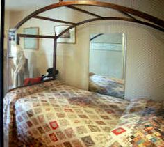 The Jane Austen quilt on a tent bed in the Jane Austen House Museum, Chawton, Hants., UK