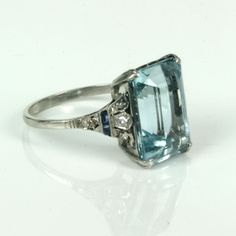 Buy Art Deco aquamarine ring in platinum from KalmarAntiques. We are one of the top antique jewellery provider from Sydney providing Sold Items, Sold Rings. Call us on 02 9264 3663 for more information.