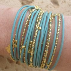 Boho Chic Beaded Wrap Bracelet Light Turquoise Leather with Gold Accents. $42.00, via Etsy.