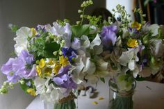 bride and bridesmaids having a drink - sweet peas, phacelia, honeysuckle, ox-eye daisies, buttercups - the english countryside tied up in three bouquets - all grown, cut and tied by @theflowerfarmer at www.commonfarmflowers.com