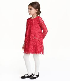 Red. Long-sleeved dress in lace. Round neckline with opening and button at back. Pleats at front and mock front pockets with zip. Jersey lining.