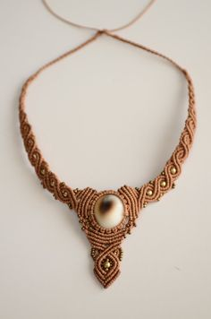 Macrame necklace with Shiva Eye Shell and Brass by JujuJewelries, €55.00