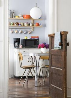 Make a dutch door from an old door. Great idea for the top of the farmhouse stairs!