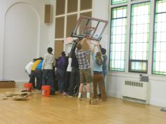Tamarack High School students helping put the basketball hoops up at the new school.