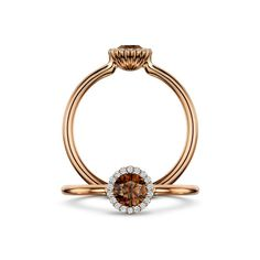 The rich hue of a chocolate coloured diamond is echoed by warm rose gold in this @andrewgeoghegan Cannelé engagement ring. The 0.33ct centre stone is surrounded by a halo of smaller, brilliant-cut white diamonds - £2,495