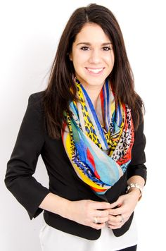 Danielle dresses up her blazer with a colorful, printed scarf.