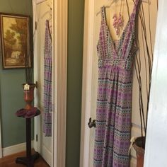 Purple beaded Maxi DressNEWListing  Tribal print in teal and lilac with a little bit of sparkle on this V crisscross v neckline. 2side slits make walking on the beach a joy lightweight and cool 95%Nylon 5%spandex machine washable brand tag removed was itchy  M/L Dresses Maxi
