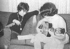 Janis Joplin, teaching her sister, Laura Joplin, guitar at home in Port Arthur