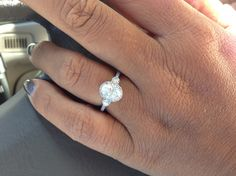 Ritani three-stone halo with an oval diamond. I love this ring!