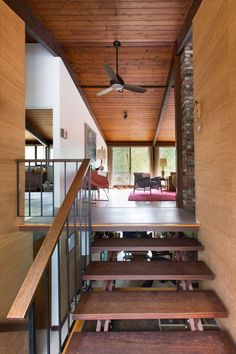A split-level staircase at the main entrance provides sight lines to both levels of the house.