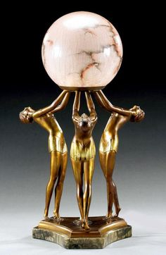 """A German art deco metal figure lamp with an original """"alabaster"""" glass globe, 1930s. *This particular lamp is probably one of the most elegant (and sought after) of the art deco period's so called """"lady lamps""""."""