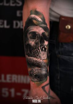 skull with rattle snake tattoo by Thomas Carli-jarlier