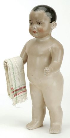 "Germany, ca. 1880, large one piece brown tinted china boy with black molded and painted brush stroked hair, hazel painted eyes, open/closed mouth with 2 molded teeth, nicely sculpted torso with clenched fists Size: 16"" t."