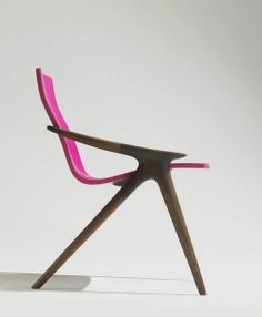 John Niero. The lines on this chair are a mix of mid-century modern & modern. The pop of pink is perfect!